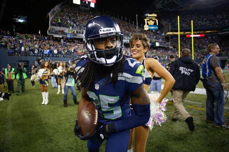Cornerback Richard Sherman of the Seattle Seahawks celebrates after making an interception in the second half against the San Francisco 49ers at CenturyLink Field on September 15, 2013 in Seattle, Washington. Photo: Otto Greule Jr, Getty Images