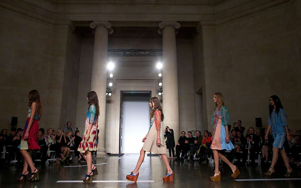 Models present creations by Jonathan Saunders during the 2014 Spring/Summer London Fashion Week in London on September 15, 2013. TOPSHOTS/AFP PHOTO/ANDREW COWIEANDREW COWIE/AFP/Getty Images