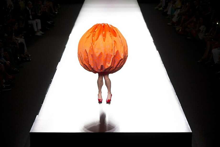 Orange is the new black:Designer Agatha Ruiz de la Prada rounds out Madrid's Fashion   Week with an ambulatory pumpkin. Photo: Daniel Ochoa De Olza, Associated Press