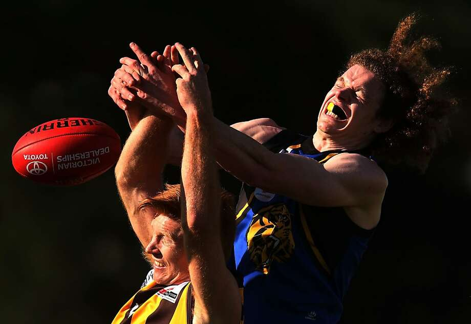 MELBOURNE, AUSTRALIA - SEPTEMBER 15: Kyle Cheney (L) of the Hawks and Ben Brown of the Tigers contest for the ball during the VFL Semi Final match between Box Hill and Werribee Tigers at North Port Oval on September 15, 2013 in Melbourne, Australia.  (Photo by Michael Dodge/Getty Images) *** BESTPIX *** Photo: Michael Dodge, Getty Images