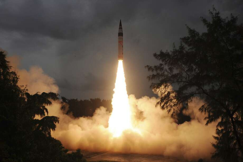 In this photo released by India's Defence Research and Development Organisation (DRDO), India's nuclear-capable missile Agni-V is test fired in Wheelar's Island, off the coast of Odisha, India, Sunday, Sept. 15, 2013. India on Sunday successfully test-fired for the second time the missile that can strike the major Chinese cities of Beijing and Shanghai, officials said. Ravi Gupta, a spokesman for the Defence Research and Development Organisation, said the latest test of the the missile a step closer to being inducted into India's arsenal at some point in 2014 or 2015. (AP Photo/DRDO) Photo: Associated Press