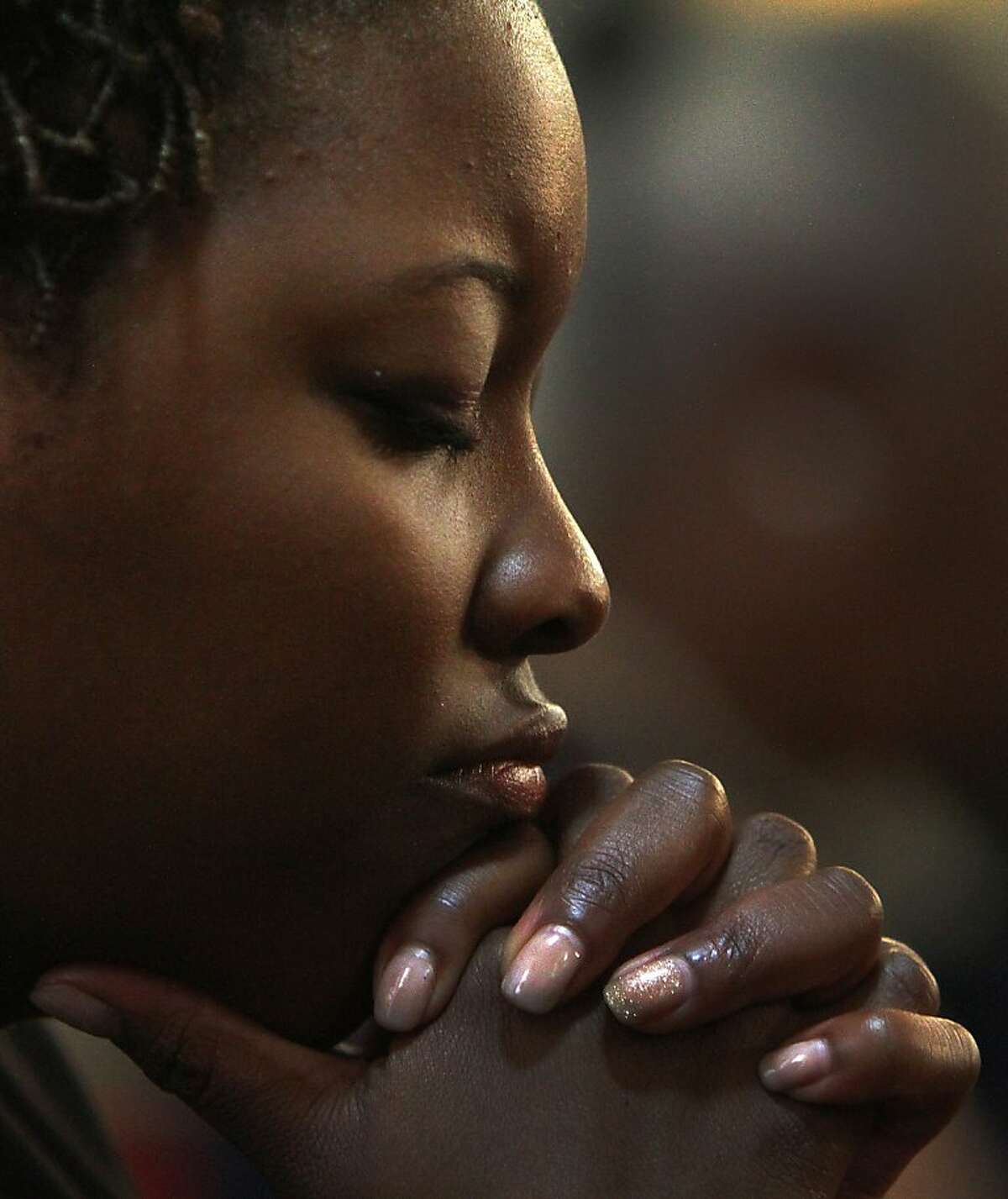 Sh'Nese Townsend of Birmimngham, Ala., prays during a memorial service at the 16th Street Baptist Church in Birmingham, Ala., Sunday, Sept. 15, 2013. The church held a ceremony honoring the memory of the four young girls who were killed by a bomb placed outside the church 50 years ago by members of the Ku Klux Klan. (AP Photo/Hal Yeager)