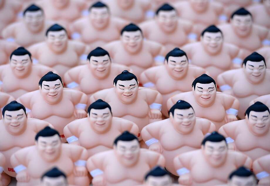 LOS ANGELES, CA - SEPTEMBER 15:  View of sumo wrestling figures during the13th US Sumo Open at the Japanese American Cultural & Community Center Plaza on September 15, 2013 in Los Angeles, California.  (Photo by Harry How/Getty Images) Photo: Harry How, Getty Images