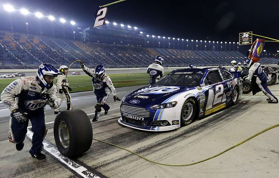 Brad Keselowski (2) makes a pit stop during the NASCAR Sprint Cup series auto race at Chicagoland Speedway in Joliet, Ill., Sunday, Sept. 15, 2013. (AP Photo/Nam Y. Huh) Photo: Nam Y. Huh, Associated Press