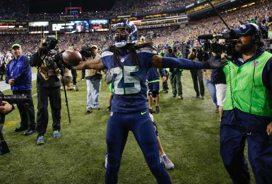 SEATTLE, WA - SEPTEMBER 15:  Cornerback Richard Sherman #25 of the Seattle Seahawks celebrates after making an interception in the second half against the San Francisco 49ers at CenturyLink Field on September 15, 2013 in Seattle, Washington. The Seahawks defeated the 49ers 29-3.  (Photo by Otto Greule Jr/Getty Images) Photo: Getty Images