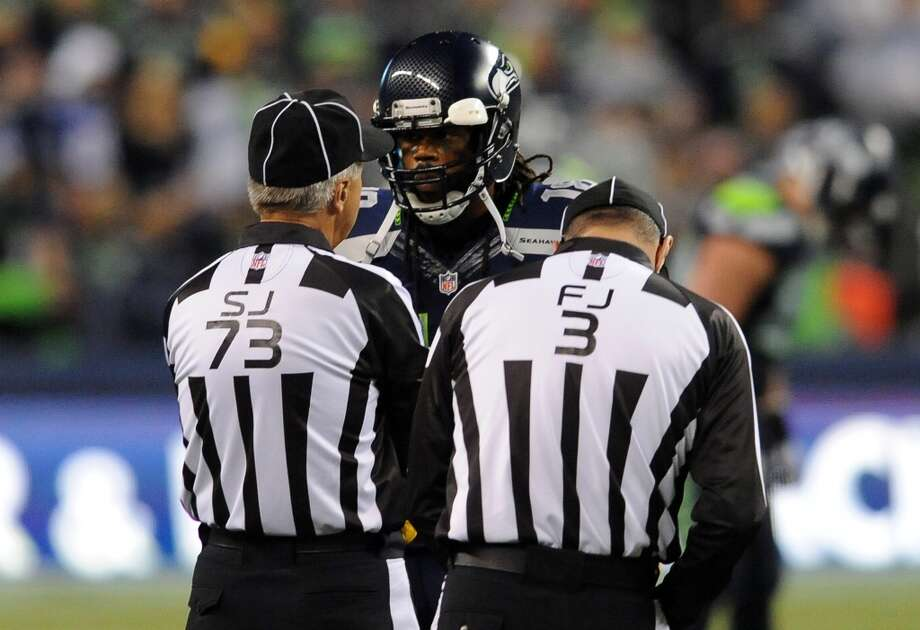 SEATTLE, WA. - SEPTEMBER 15: Wide receiver Sidney Rice #18 of the Seattle Seahawks pleads his case with side judge Joe Larrew #73 and field judge Scott Edwards #3 during the second quarter of the game against the San Francisco 49ers at Century Link Field on September 15, 2013 in Seattle, Washington. (Photo by Steve Dykes/Getty Images) Photo: Getty Images