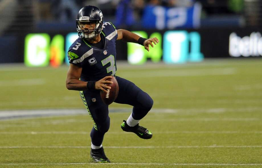 SEATTLE, WA. - SEPTEMBER 15: Quarterback Russell Wilson #3 of the Seattle Seahawks scrambles out of the pocket during the fourth quarter of the game against the Seattle Seahawks at Century Link Field on September 15, 2013 in Seattle, Washington. (Photo by Steve Dykes/Getty Images) Photo: Getty Images