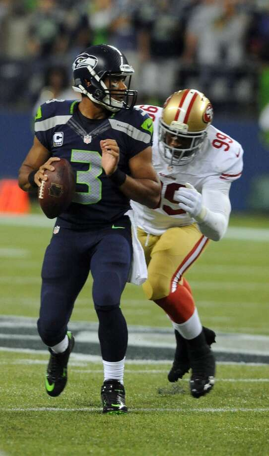 SEATTLE, WA - SEPTEMBER 15: Outside linebacker Aldon Smith #99 of the San Francisco 49ers cloes in to sack quarterback Russell Wilson #3 of the Seattle Seahawks during the second quarter of the game at Century Link Field on September 15, 2013 in Seattle, Washington. (Photo by Steve Dykes/Getty Images) Photo: Getty Images