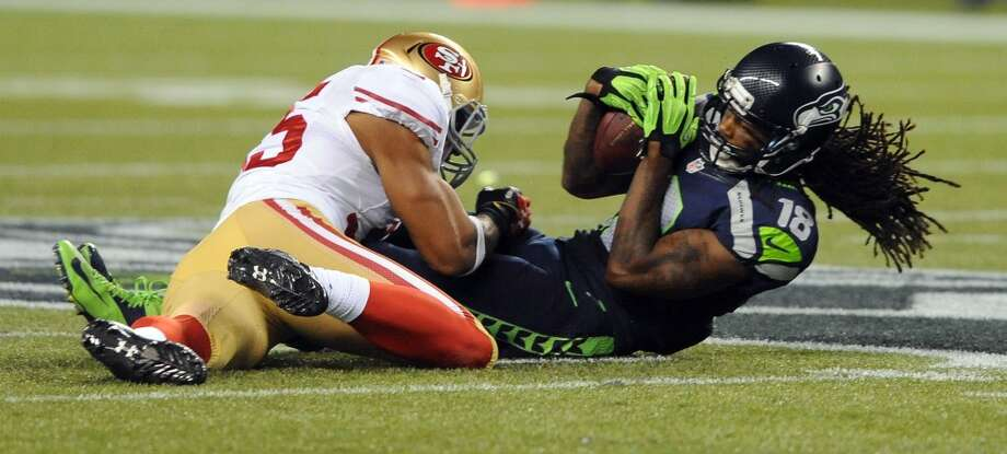 SEATTLE, WA. - SEPTEMBER 15: Free safety Eric Reid #35 of the San Francisco 49ers hits wide receiver Sidney Rice #18 of the Seattle Seahawks as he catches the ball during the second quarter of the game at Century Link Field on September 15, 2013 in Seattle, Washington. (Photo by Steve Dykes/Getty Images) Photo: Getty Images