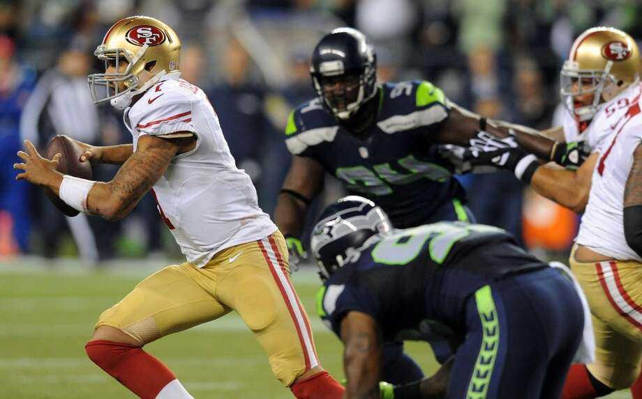 SEATTLE, WA. - SEPTEMBER 15: Quarterback Colin Kaepernick #7 of the San Francisco 49ers scrambles out of the pocket during the second quarter of the game against the Seattle Seahawks at Century Link Field on September 15, 2013 in Seattle, Washington. (Photo by Steve Dykes/Getty Images) Photo: Getty Images