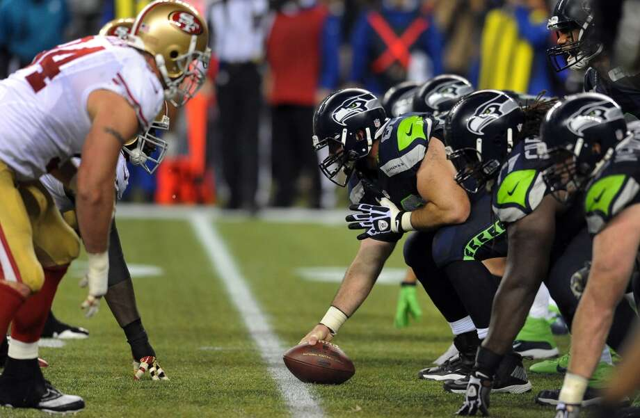 SEATTLE, WA. - SEPTEMBER 15: Center Max Unger #60 of the Seattle Seahawks lines up his team during the third quarter of the game against the San Francisco 49ers at Century Link Field on September 15, 2013 in Seattle, Washington. (Photo by Steve Dykes/Getty Images) Photo: Getty Images