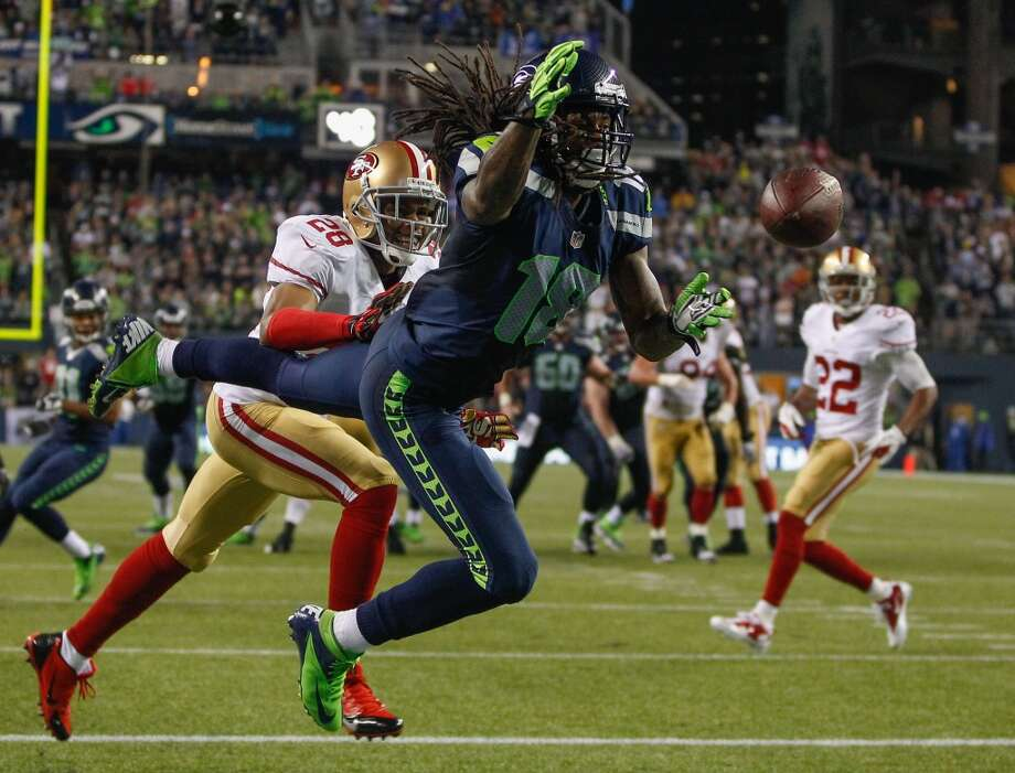 SEATTLE, WA - SEPTEMBER 15:  Wide receiver Sidney Rice #18 of the Seattle Seahawks just misses making a touchdown catch against Nnamdi Asomugha #28 of the San Francisco 49ers at CenturyLink Field on September 15, 2013 in Seattle, Washington. The Seahawks defeated the 49ers 29-3.  (Photo by Otto Greule Jr/Getty Images) Photo: Getty Images