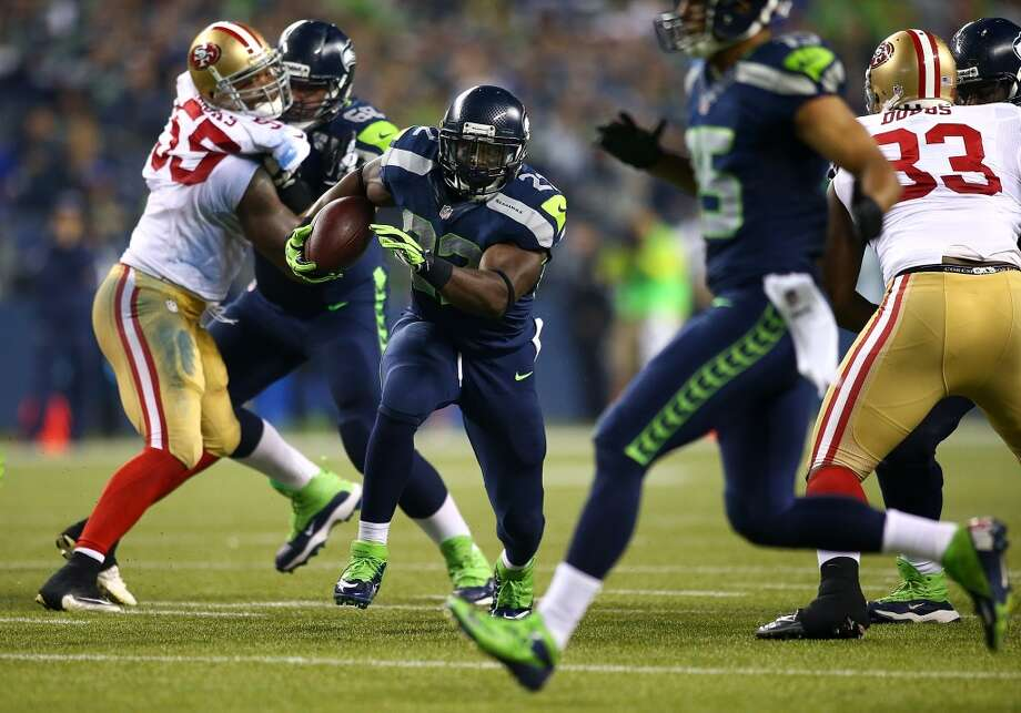 SEATTLE - SEPTEMBER 15:  Robert Turbin #22 of the Seattle Seahawks runs the ball against the San Francisco 49ers on September 15, 2013 at Century Link Field in Seattle, Washington.  (Photo by Jonathan Ferrey/Getty Images) Photo: Getty Images