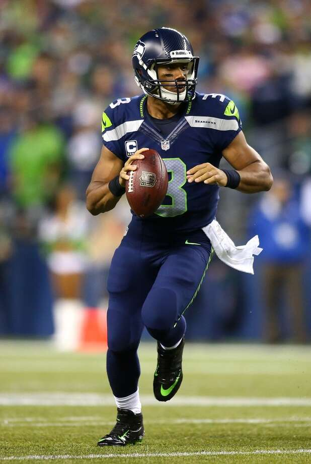 SEATTLE - SEPTEMBER 15:  Quarterback Russell Wilson #3 of the Seattle Seahawks looks to throw against the San Francisco 49ers on September 15, 2013 at Century Link Field in Seattle, Washington.  (Photo by Jonathan Ferrey/Getty Images) Photo: Getty Images
