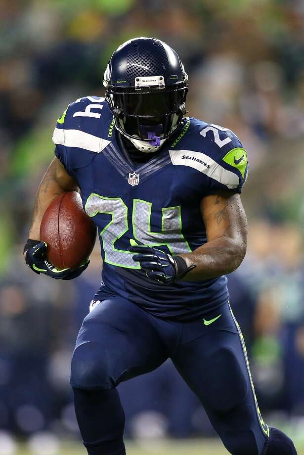SEATTLE - SEPTEMBER 15:  Marshawn Lynch #24 of the Seattle Seahawks runs the ball against the San Francisco 49ers on September 15, 2013 at Century Link Field in Seattle, Washington.  (Photo by Jonathan Ferrey/Getty Images) Photo: Getty Images