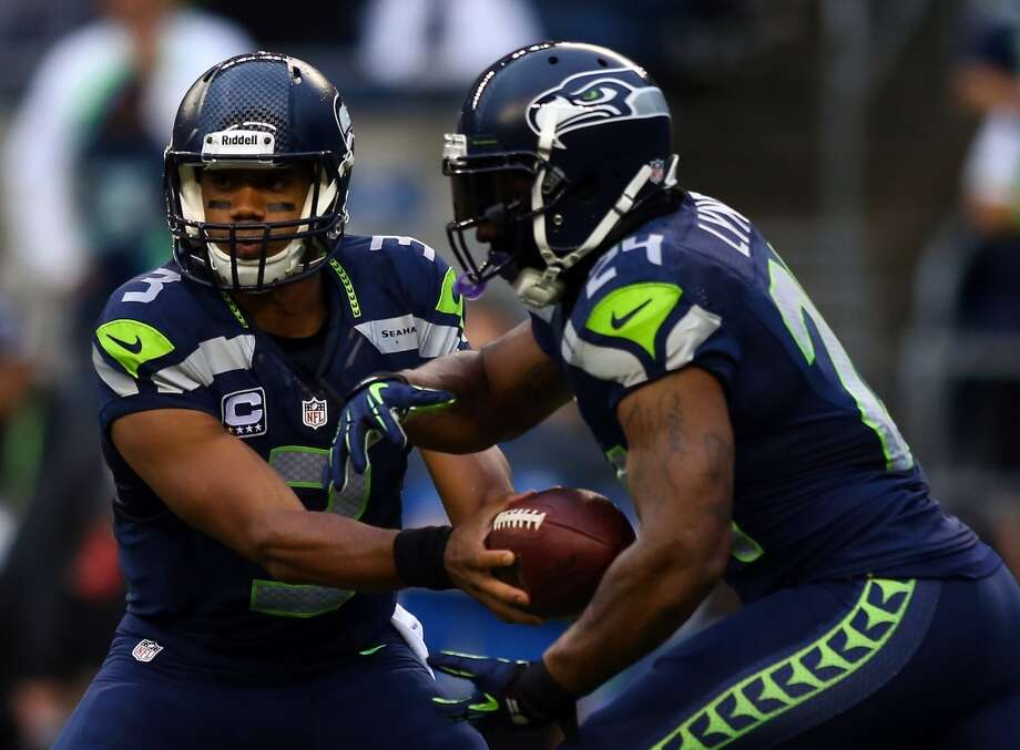 SEATTLE, WA - SEPTEMBER 15:  Russell Wilson #3 of the Seattle Seahawks hands the ball off turnover  Marshawn Lynch #24 of the Seattle Seahawks during their game at Qwest Field on September 15, 2013 in Seattle, Washington.  (Photo by Jonathan Ferrey/Getty Images) Photo: Getty Images