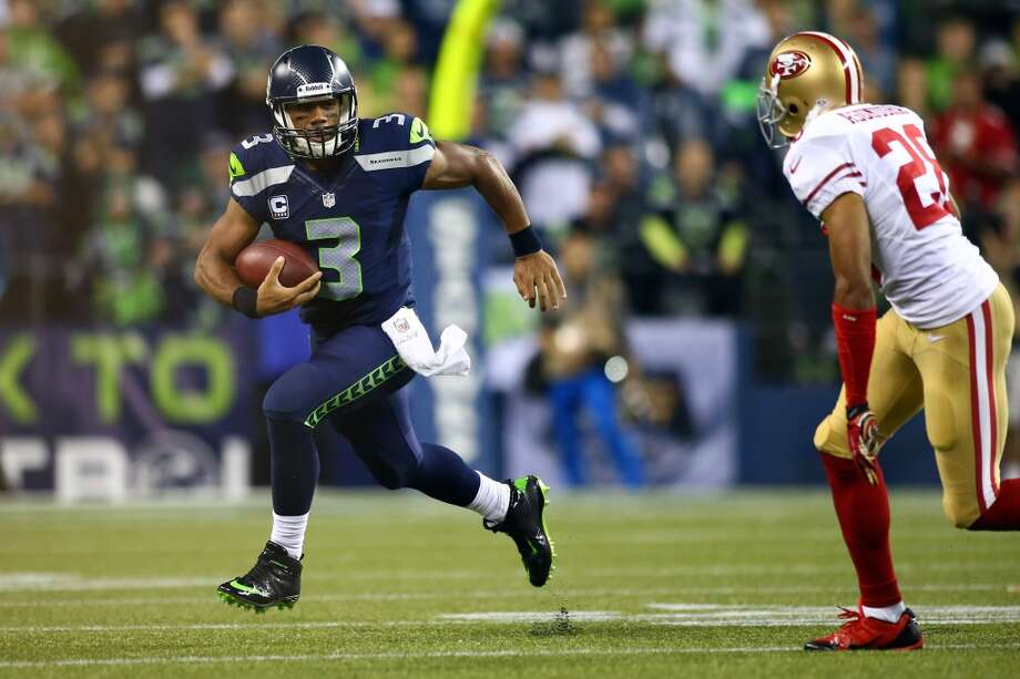 SEATTLE, WA - SEPTEMBER 15:  Russell Wilson #3 of the Seattle Seahawks runs the ball against the San Francisco 49ers during their game at Qwest Field on September 15, 2013 in Seattle, Washington.  (Photo by Jonathan Ferrey/Getty Images) Photo: Getty Images