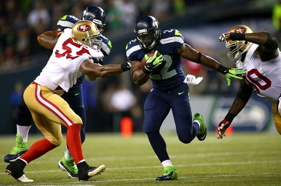 SEATTLE - SEPTEMBER 15:  Robert Turbin #22 of the Seattle Seahawks runs the ball past Ahmad Brooks #55 of the San Francisco 49ers on September 15, 2013 at Century Link Field in Seattle, Washington.  (Photo by Jonathan Ferrey/Getty Images) Photo: Getty Images
