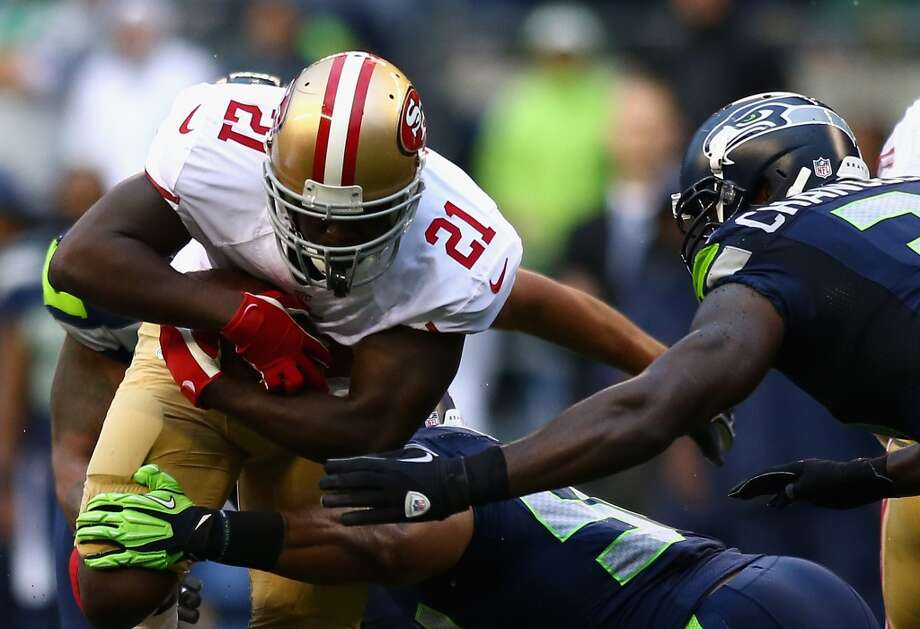 SEATTLE, WA - SEPTEMBER 15:   Frank Gore #21 of the San Francisco 49ers runs the ball against the Seattle Seahawks during their game at Qwest Field on September 15, 2013 in Seattle, Washington.  (Photo by Jonathan Ferrey/Getty Images) Photo: Getty Images