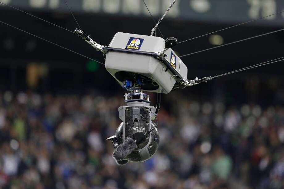 A camera is suspended over the field during an NFL football game between the Seattle Seahawks San Francisco 49ers, Sunday, Sept. 15, 2013, in Seattle. (AP Photo/Elaine Thompson) Photo: AP