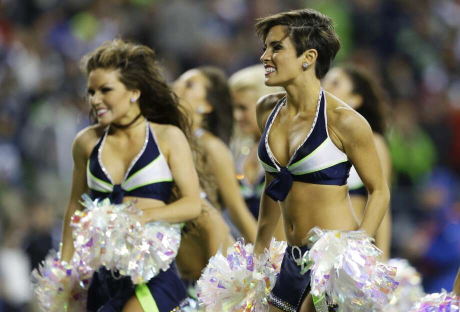Seattle Seahawks Sea Gals cheerleaders dance during an NFL football game between the Seahawks and San Francisco 49ers in the second half of an NFL football game, Sunday, Sept. 15, 2013, in Seattle. (AP Photo/Elaine Thompson) Photo: AP