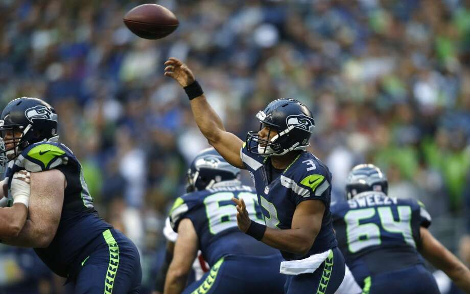 Seattle Seahawks quarterback Russell Wilson makes a pass against the San Francisco 49ers in the first half of an NFL football game, Sunday, Sept. 15, 2013, in Seattle. (AP Photo/John Froschauer) Photo: AP