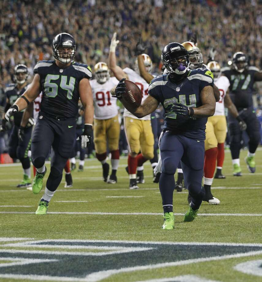 Seattle Seahawks' Marshawn Lynch (24) runs for a touchdown against the San Francisco 49ers in the second half of an NFL football game, Sunday, Sept. 15, 2013, in Seattle. (AP Photo/John Froschauer) Photo: ASSOCIATED PRESS