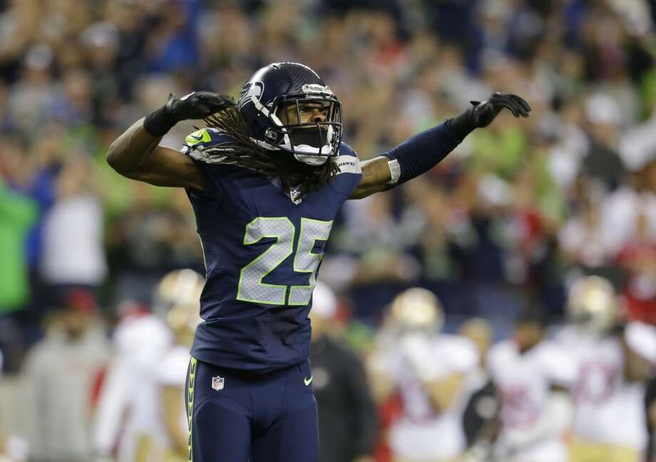 Seattle Seahawks' Richard Sherman celebrates after the Seahawks score a safety in the first half of an NFL football game against the San Francisco 49ers, Sunday, Sept. 15, 2013, in Seattle. (AP Photo/Elaine Thompson) Photo: AP