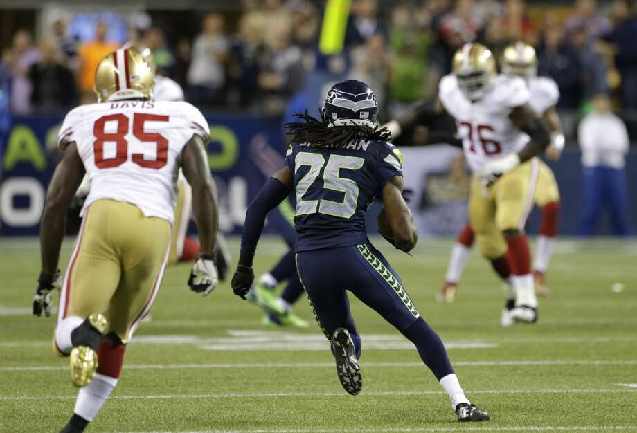 Seattle Seahawks' Richard Sherman (25) returns an interception against the San Francisco 49ers in the second half of an NFL football game, Sunday, Sept. 15, 2013, in Seattle. (AP Photo/Elaine Thompson) Photo: AP