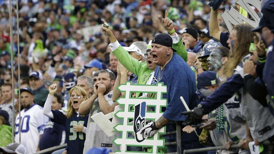Seattle Seahawks' fans yell from the stands  at Century Link Field during an NFL football game against the San Francisco 49ers, Sunday, Sept. 15, 2013, in Seattle. A new Guinness World Record for loudest crowd roar at a sports stadium was set during the game. (AP Photo/Elaine Thompson) Photo: AP