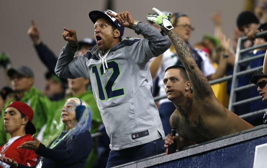 Seattle Seahawks' fans yell from the stands  in Century Link Field during an NFL football game against the San Francisco 49ers, Sunday, Sept. 15, 2013, in Seattle. A new Guinness World Record for loudest crowd roar at a sports stadium was set during the game. (AP Photo/John Froschauer) Photo: AP