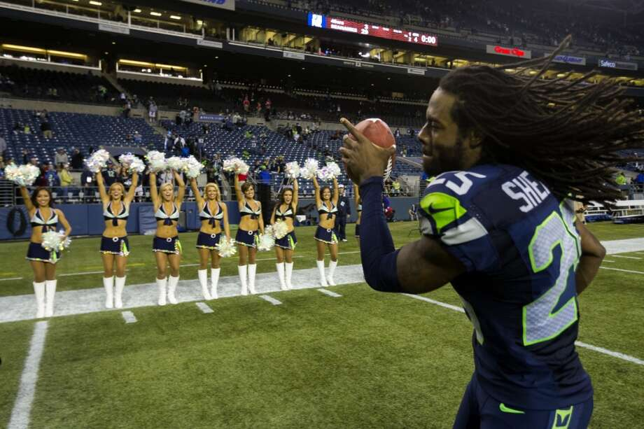 Richard Sherman, right, runs off the field after beating the 49ers 29-3 in the home opener. Photo: JORDAN STEAD, SEATTLEPI.COM
