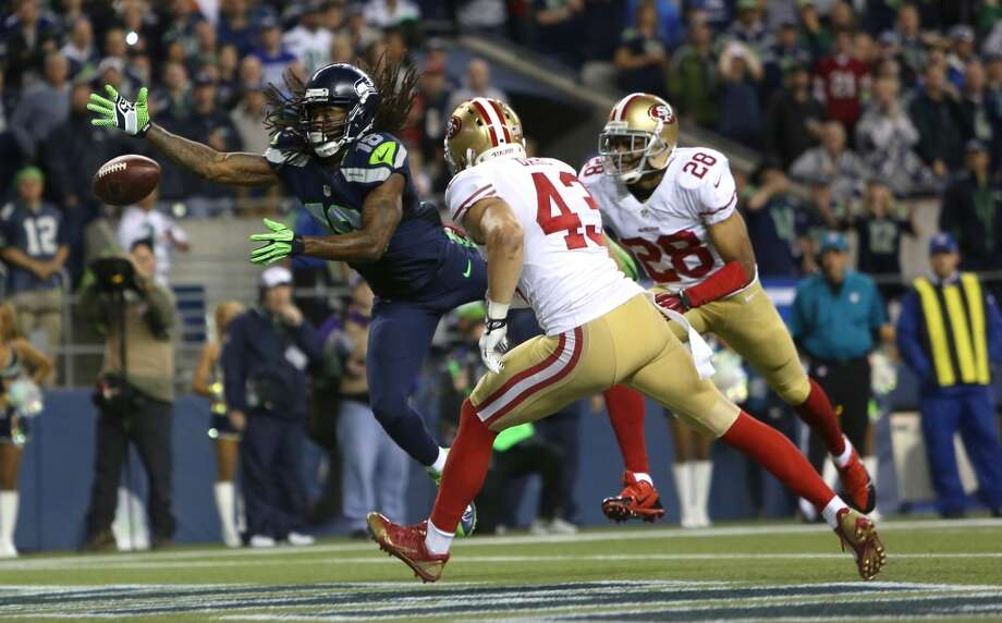 Seattle Seahawks Sidney Rice unsuccessfully reaches for the ball against San Francisco 49ers players Craig Dahl (43) and Nnamdi Asomugha (28). Photo: JOSHUA TRUJILLO, SEATTLEPI.COM