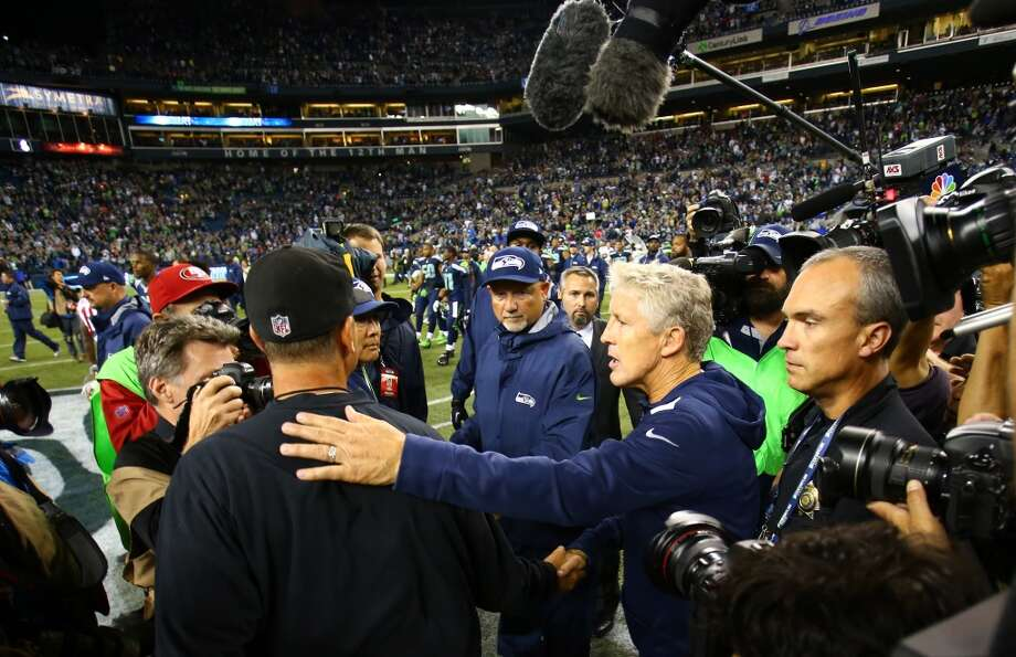 Seattle Seahawks coach Pete Carroll greets San Francisco 49ers coach Jim Harbaugh after the Hawks defeated the 49ers 29-3. Photo: JOSHUA TRUJILLO, SEATTLEPI.COM