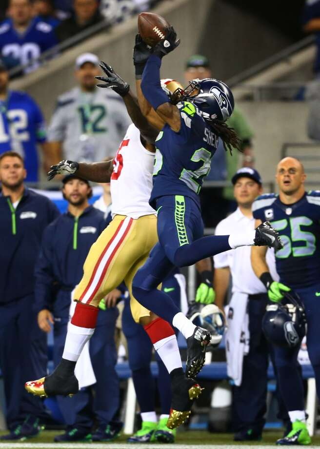 Seattle Seahawks player Richard Sherman pulls down an interception from San Francisco 49ers player Vernon Davis. Photo: JOSHUA TRUJILLO, SEATTLEPI.COM