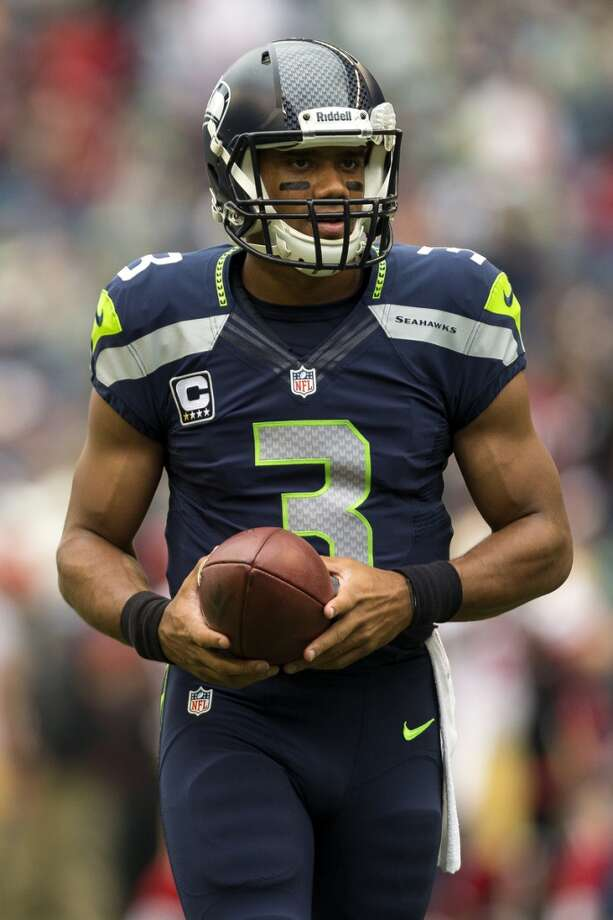 Seahawks quarterback Russell Wilson warms up. Photo: JORDAN STEAD, SEATTLEPI.COM