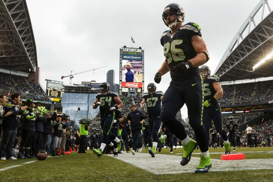 Players retreat to the locker room after warm ups. Photo: JORDAN STEAD, SEATTLEPI.COM