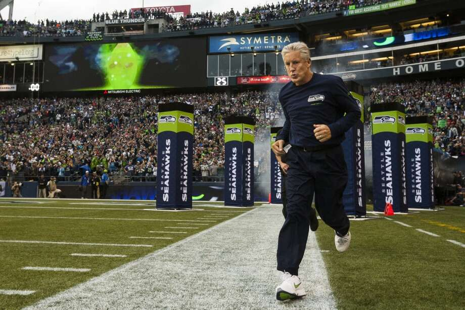 Seahawks head coach Pete Carroll enters the field at the beginning of the home opener. Photo: JORDAN STEAD, SEATTLEPI.COM