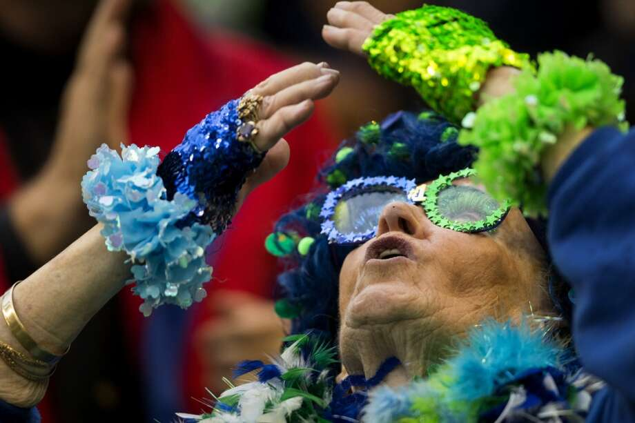 A super fan blows kisses to the sky during the first quarter of the home opener. Photo: JORDAN STEAD, SEATTLEPI.COM