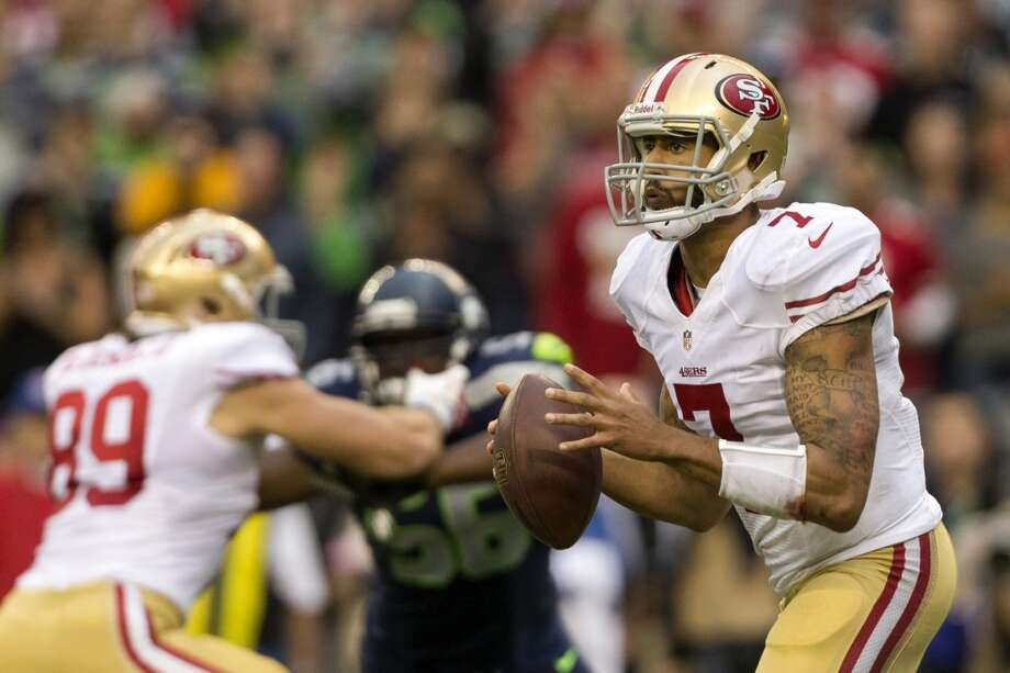 San Francisco 49ers' quarterback Colin Kaepernick, right, prepares to throw to a teammate. Photo: JORDAN STEAD, SEATTLEPI.COM