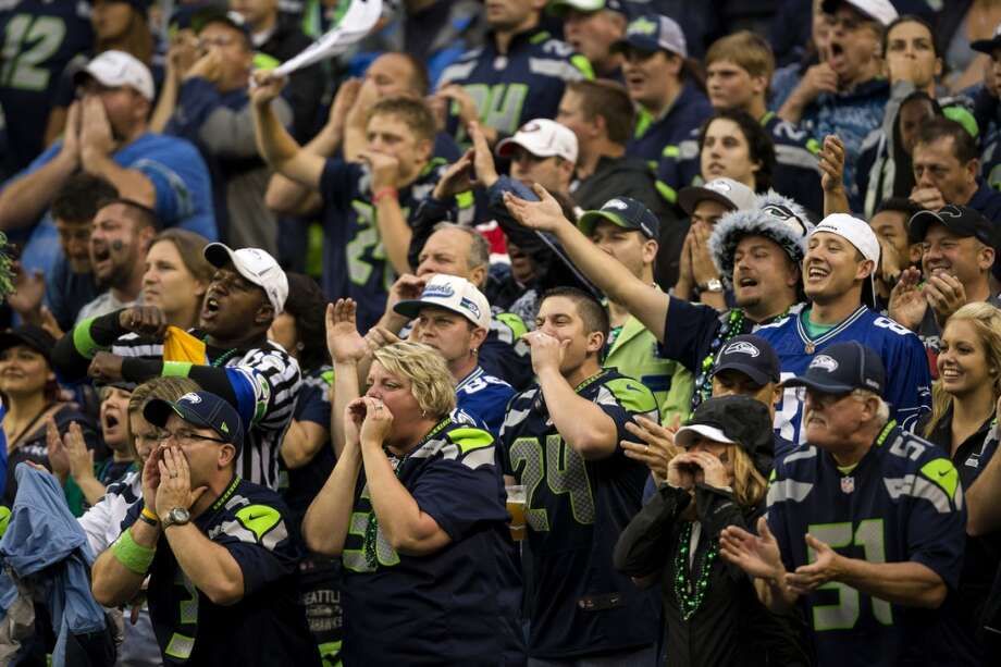 Fans scream following a play in the Seahawks' favor during the first quarter. Photo: JORDAN STEAD, SEATTLEPI.COM