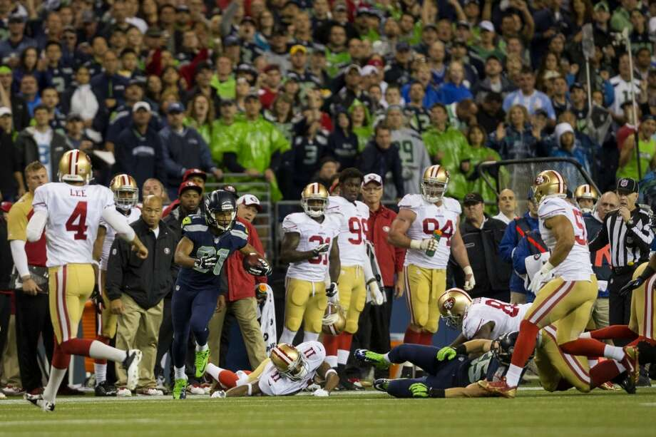 Golden Tate, left, makes a breakaway downfield during the first half of the home opener. Photo: JORDAN STEAD, SEATTLEPI.COM