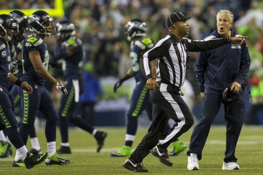 Seahawks head coach Pete Carroll, right, objects to the referee's call during the first half of the home opener. Photo: JORDAN STEAD, SEATTLEPI.COM