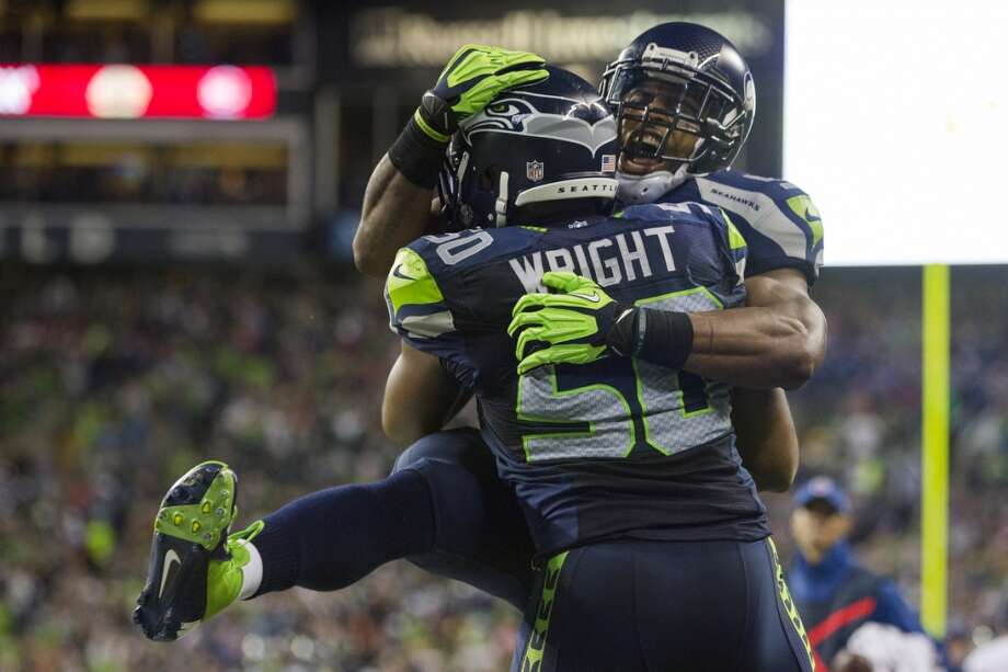Seahawks players celebrate during the first half of the home opener. Photo: JORDAN STEAD, SEATTLEPI.COM