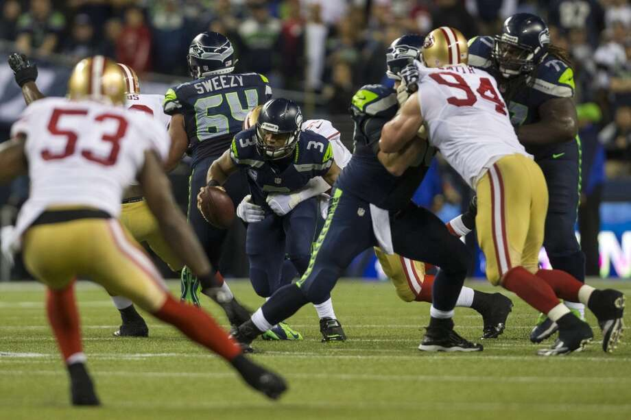 Seahawks quarterback Russell Wilson attempts to break away for a run downfield. Photo: JORDAN STEAD, SEATTLEPI.COM