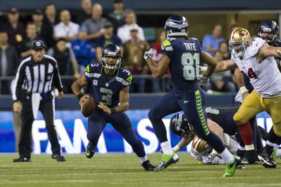 Seahawks quarterback Russell Wilson looks for an open teammate during the second half of the home opener. Photo: JORDAN STEAD, SEATTLEPI.COM