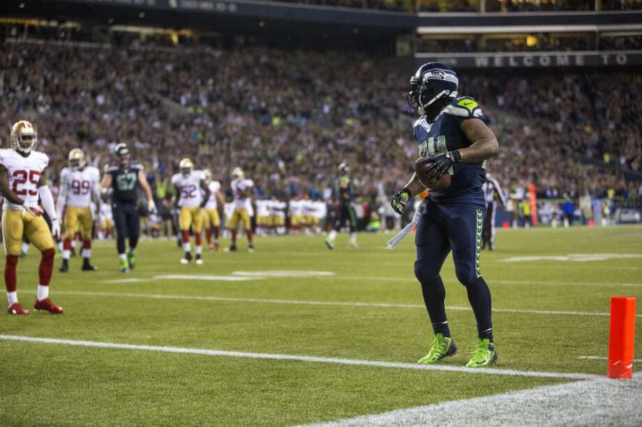 Seahawk Marshawn Lynch, right, casually walks into the end zone for his second of three touchdowns of the night during the second half of the home opener against the San Francisco 49ers. Photo: JORDAN STEAD, SEATTLEPI.COM