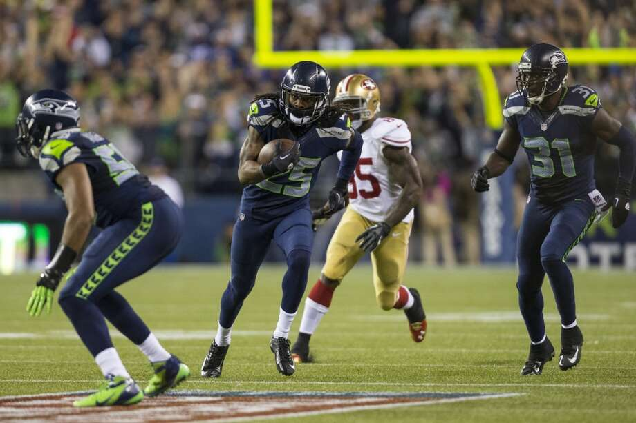 Richard Sherman, center left, makes a run following an interception during the second half. Photo: JORDAN STEAD, SEATTLEPI.COM