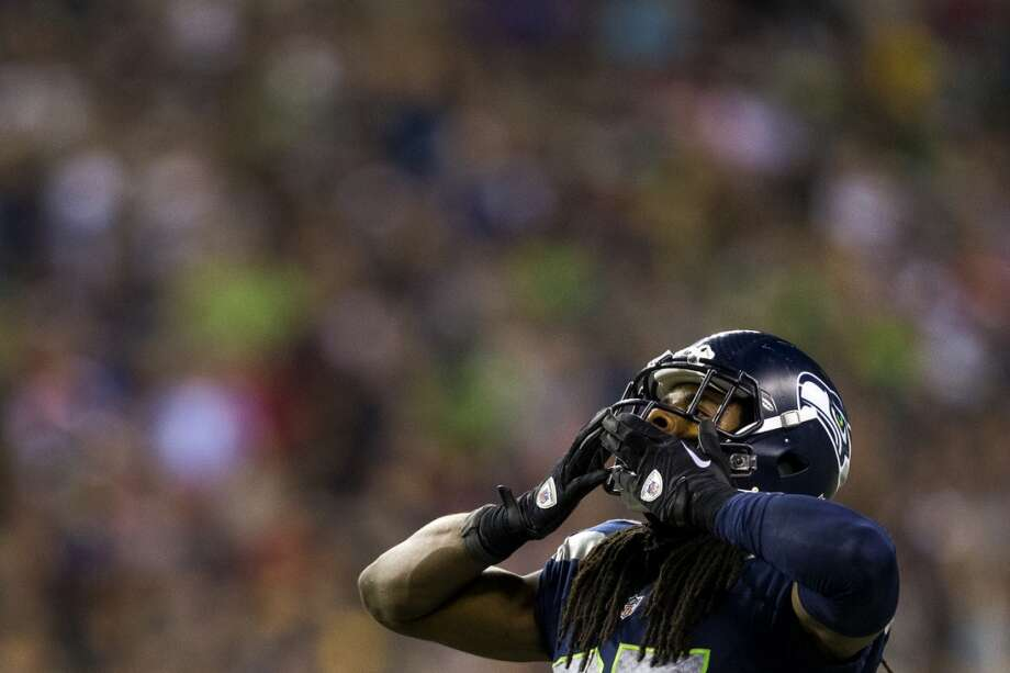 Richard Sherman blows kisses to the crowd during the second half. Photo: JORDAN STEAD, SEATTLEPI.COM