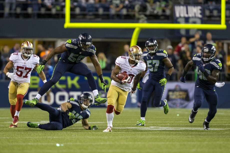 Seahawks chase after Kyle Williams, center, of the 49ers, during the second half of the home opener. Photo: JORDAN STEAD, SEATTLEPI.COM